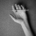 Woman hand and drug Syringe Royalty Free Stock Photo