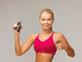 Woman with hand expander beautiful sporty showing thumbs up Royalty Free Stock Photography