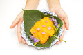 Woman hand give  a lai thai dish of thai desert Royalty Free Stock Image