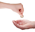Woman hand giving euro coin to man hand isolated on white background Royalty Free Stock Images