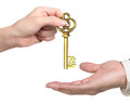 Woman hand giving pound sign treasure key to man hand Royalty Free Stock Photo