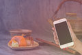Woman hand hold smart phone on blurred japanese sushi set Royalty Free Stock Photo