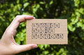 Woman hand holding cardboard card with words Reduce Reuse Recycl Royalty Free Stock Photo