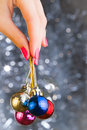 Woman hand holding christmas balls over bekeh background with copyspace Stock Images