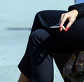 Woman hand holding cigarette Royalty Free Stock Photo