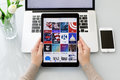Woman hand holding iPad Pro with popular news applications Royalty Free Stock Photo