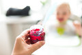 Woman hand holding a jar of beetroot puree Royalty Free Stock Photo