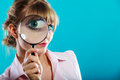 Woman hand holding magnifying glass on eye Royalty Free Stock Photo