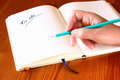 Woman hand holding pencil and opened notebook with a to do list Royalty Free Stock Photos