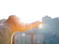 Woman hand holding the sun