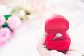Woman hand holding wedding ring in red box, Wedding or Engagement Concept Royalty Free Stock Photo
