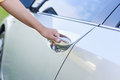 Woman hand opening the car door Royalty Free Stock Photo