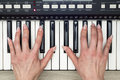 Woman hand playing a MIDI controller keyboard synthesizer close up Royalty Free Stock Photo