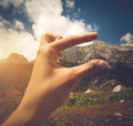 Woman Hand scaling mountain height from camping Royalty Free Stock Photo