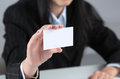 Woman Hand showing a blank business card Royalty Free Stock Photo