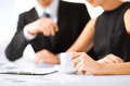Woman hand signing contract paper picture of women Royalty Free Stock Image
