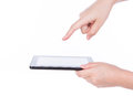 Woman hand using a touch screen device. Stock Photos