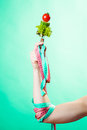 Woman hand with vegetarian food and measuring tapes diet weight loss concept dietician colorful on green blue background Royalty Free Stock Image