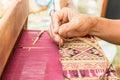 Woman hand weaving thai silk Royalty Free Stock Photo