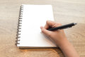 Woman hand writing on notebook Royalty Free Stock Photo