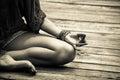 Woman hand in yoga symbolic gesture mudra bw outdoor