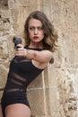 Woman with handgun aiming