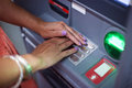 Woman hands on atm machine Stock Image