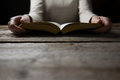 Woman hands on bible. she is reading and praying Royalty Free Stock Photo