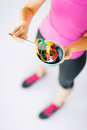 Woman hands holding bowl with measuring tape sport and diet concept Royalty Free Stock Image