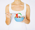 Woman hands holding bowl with measuring tape sport and diet concept Royalty Free Stock Photos