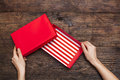 Woman hands holding empty gift box on wooden background Royalty Free Stock Photo