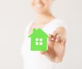 Woman hands holding green house closeup picture of Stock Photo