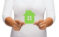 Woman hands holding green house real estate and eco concept closeup picture of Royalty Free Stock Photography