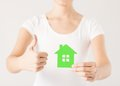 Woman hands holding green house showing thumbs up Royalty Free Stock Photos
