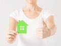 Woman hands holding green house showing thumbs up Stock Photography