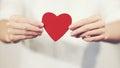 Woman hands holding Heart shape Love symbol