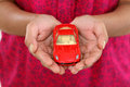 Woman hands holding red toy car Royalty Free Stock Photo