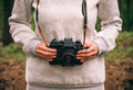 Woman hands holding retro photo camera outdoor Royalty Free Stock Photo