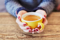 Woman hands with red manicure and cup of coffee Royalty Free Stock Photo