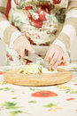 Woman hands slicing cabbage Royalty Free Stock Images