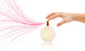 Woman hands spraying colorful lines close up of from beautiful perfume bottle Royalty Free Stock Photos
