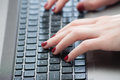 Woman hands typing on laptop keyboard Royalty Free Stock Photo