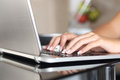 Woman hands working with a laptop at home close up of Royalty Free Stock Images