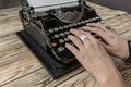 Woman Hands writing on old typewriter Royalty Free Stock Photo