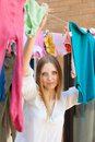 Woman hanging clothes to dry on clothes line after laundry Stock Image