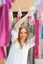Woman hanging clothes to dry after laundry long haired on line Royalty Free Stock Images