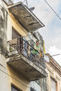 Woman hanging laundry from balcony havana in old cuba Royalty Free Stock Photos