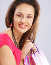 Woman happy holding shopping bags beautiful Stock Photos