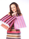Woman happy holding shopping bags beautiful Stock Photography