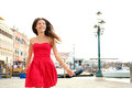 Woman happy running in summer dress, Venice, Italy Stock Image